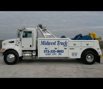 WALK AROUND OF OUR 20 TON SINGLE AXLE PETERBILT 337 TOWING AND RECOVERY UNIT.